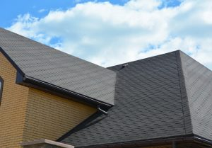 The hip roof is a popular roof type for residential roofing.